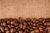 Coffee Beans On Burlap Background. Roasted Coffee Beans Isolated In White Background. Roasted Coffee poster