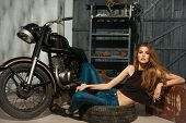 Sexy Girl Lying In Dirty Rubber Tire On Floor poster