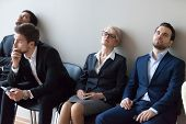 Diverse Applicants Getting Bored In Queue Waiting For Job Interview poster