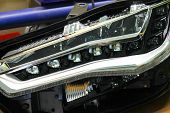 Macro View Of Repairing, Installation And Turning Headlight Of Modern Automobile And Car Projector L poster