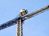 Construction Crane Near The Building Under Construction. Self-erection Crane. poster