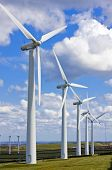 foto of wind energy  - Modern windmills in wind - JPG