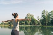 Young Asian Woman Yoga Outdoors Keep Calm And Meditates While Practicing Yoga To Explore The Inner P poster