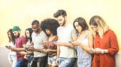 Multiracial Friends Using Mobile Smartphone At University Coampus - Millenial People Addicted By Sma poster