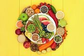 Vegan health food with fresh fruit and vegetables, grains, nuts, seeds, sos mix, quinoa balls, spice poster