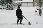 Senior Shoveling Driveway