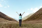 Woman In A Mountain Valley Arms Raised In The Sky Travel Lifestyle Concept Of Success Adventure Adve poster
