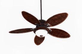 stock photo of light fixture  - dark brown tropical wicker ceiling fan with light fixture - JPG