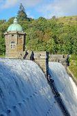 Penygarreg reservoir overflowing water, Elan Valley, Wales.