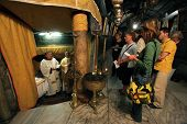 BETHLEHEM-OCTOBER 05: Mass in a Grotto of Nativity. The Basilica of the Nativity is one of Bethlehem's major tourist attractions and a magnet for Christian pilgrims, Bethlehem, Israel on Oct 05, 2006.