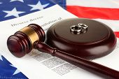 picture of divorce-papers  - Divorce decree and wooden gavel on american flag background - JPG