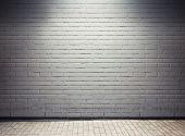 Spotlight on empty street wall.