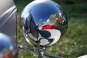 image of street-rod  - Reflections of street rod cars on the back of a headlight on another hot rod - JPG