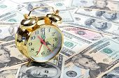 Alarm clock  for dollar banknotes close up