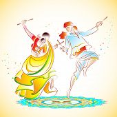 image of navratri  - illustration of couple playing dandiya on rangoli - JPG