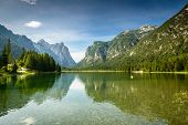 stock photo of lagos  - Summer landscape with peaceful lake and mountains in background - JPG