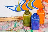 foto of batik  - painting and bottles with dyes for cold batik painting - JPG