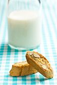 cantuccini cookies and milk on checkered tablecloth