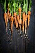 stock photo of carrot  - Carrots on wooden table background - JPG