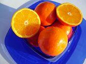 pic of tangelo  - fresh cut tangelos on a blue platter   - JPG