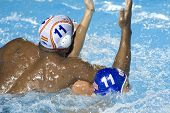 Jul 30 2009; Rome Italy; USA team player Jesse Smith (blue cap) and Spain team player Ivan Perez competing for position in the semi final match between USA and Spain