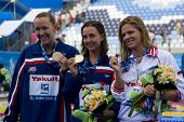 Jul 28 2009; Rome Italy; Kasey Carlson (USA) bronze medal winner, left Rebecca Soni (USA) gold medal winner, centre and Yuliya Efimova (RUS) silver medal winner, right in the 100m breaststroke