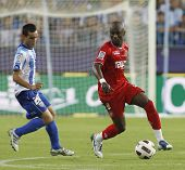 MALAGA, SPAIN. 19/09/2010. Juanmi the Malaga forward and Didier Zokora a Sevilla midfield player in