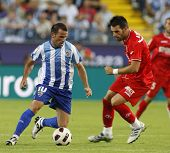 MALAGA, SPAIN. 19/09/2010. Apo�?�?�?�±o the Malaga midfielder is watched by �?�?�?�lvaro