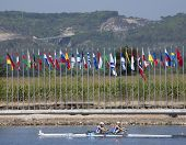MONTEMOR-O-VELHO, PORTUGAL 11/09/2010. Finnish rowers race past the flags of the competing nations a