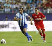 MALAGA, SPAIN. 19/09/2010. Jesus G�?�?�?�¡mez the Malaga defender and Fernando Navarro a Sevill