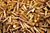 foto of bullet  - A close up image of a pile of bullets - JPG