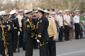 SEVASTOPOL, UKRAINE - MAY 7: Vice admirals Fedotenkov, Russia, right and Ilyin, Ukraine, handshakes