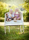 stock photo of lolli  - Two happy kids eating lolly in the park - JPG