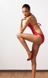 pic of monokini  - Young slender female fashion model of mixed Creole and African - JPG
