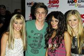 ANAHEIM - JULY 22: Miley Cyrus and Jesse McCartney with Vanessa Anne Hudgens and AJ Michalka at the Radio Disney Totally 10 Birthday Concert at Anaheim Pond on July 22, 2006 in Anaheim, CA.