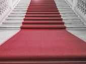 stock photo of stairway  - Red carpet on a stairway used to mark the route taken by heads of state vips and celebrities on ceremonial and formal occasions or events - JPG