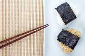Japanese food Onigiri rice ball and eat with chopsticks