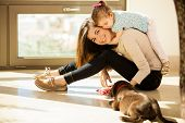 picture of puppies mother dog  - Beautiful young Hispanic mother with a baby girl and a cute Labrador puppy at home - JPG