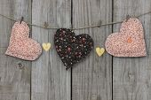 Peach and brown country hearts and gold hearts hanging on clothesline