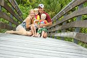 Happy Family On Tropical Boardwalk