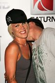 HOLLYWOOD - AUGUST 02: Pink and Carey Hart at Saturn's X-Games 12 Party at 6820 Hollywood Blvd on Au