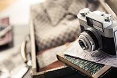 stock photo of leaving  - Vintage travel equipment with old camera and suitcase - JPG