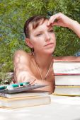 Young woman, studying and thinking hard