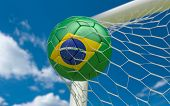 Brazil Flag And Soccer Ball In Goal Net