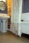 image of clawfoot  - retro bathroom with pedestal sink and clawfoot tub - JPG