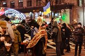 Kiev (kyiv), Ukraine - December 4, 2013: Euromaidan Protesters Rest.  Orthodox Priest Talks With Pro