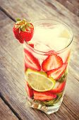 stock photo of strawberry plant  - strawberry mojito on the dark wood background - JPG
