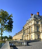 Beautiful Park with pond of ancient Fontainebleau palace. Palace of Fontainebleau - one of the large