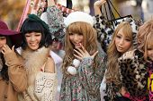 TOKYO,JAPAN, NOVEMBER 25, 2011: A group of girls is posing in the middle of the street for fashion a
