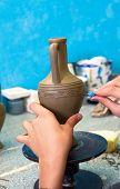 Potter Carving Pattern On Ceramics